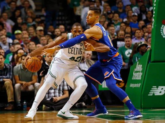 New York Knicks center Willy Hernangomez reaches in
