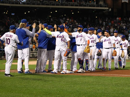 Aug 8, 2017; New York City, NY, USA; The New York Mets react after defeating the Texas Rangers at Citi Field.