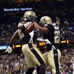 New Orleans Saints tight end Benjamin Watson (82) and running back Mark Ingram (22) celebrate after a touchdown in the third quarter of Sunday's game against the New York Giants at the Mercedes-Benz Superdome. New Orleans won 52-49.