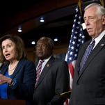 Rep. Steny Hoyer, D-Md., stands with fellow Democrats.