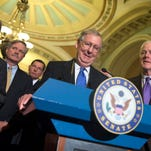 Senate Minority Leader Mitch McConnell R-Ky., smiles during a news conference on Capitol Hill Thursday. From left are, Sen. Roy Blunt, R-Mo., Sen. John Hoeven, R-N.D., Sen. John Barrasso, R-Wyo., McConnell and Senate Minority Whip John Cornyn of Texas.