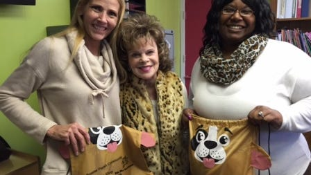 In an effort to promote literacy, Bossier Schools distributed some 2,000 books and book bags for children to take home.