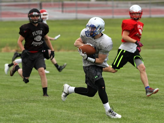 Wynford's Nick Looker runs with the ball during the north practice at Shelby High School practice field for the NCO All-Star Football classic on Tuesday.