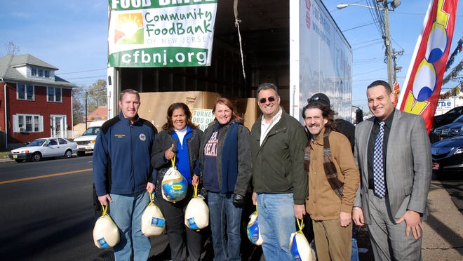 (From left) Union County Freeholder Chairman Christopher Hudak, Freeholder Linda Cater, Teamsters driver Donna Wright, Freeholder Alexander Mirabella, Quality Auto Center Business Development Manager Harry Brooks and owner Mark Abaid participated in and contributed to a holiday food collection drive conducted by the Quality Auto Center in Linden in conjunction with the Community Food Bank of New Jersey.