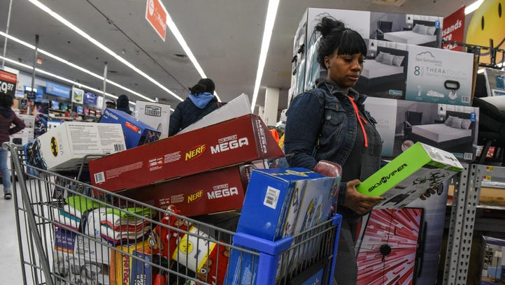 A woman shops at Walmart near the Green Acres Mall