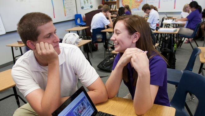Stephen Naramore and Lauren Zemlock talk in their Service Learning class at Gilbert Classical Academy in this file photo from 2011.