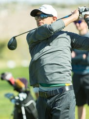 Mayfield High School golfer Diego Urib watches his