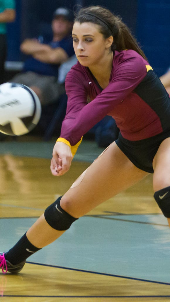 McCutcheon's Jade Humphrey returns the ball against Central Catholic Tuesday, August 19, 2014, at CC in Lafayette. McCutcheon won 3-1