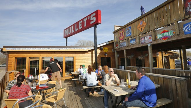 A sunny day on the deck at Mullet's Monday, April 21, 2014.