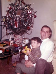 Peter Bevilacqua sits on his father, Joseph Bevilacqua