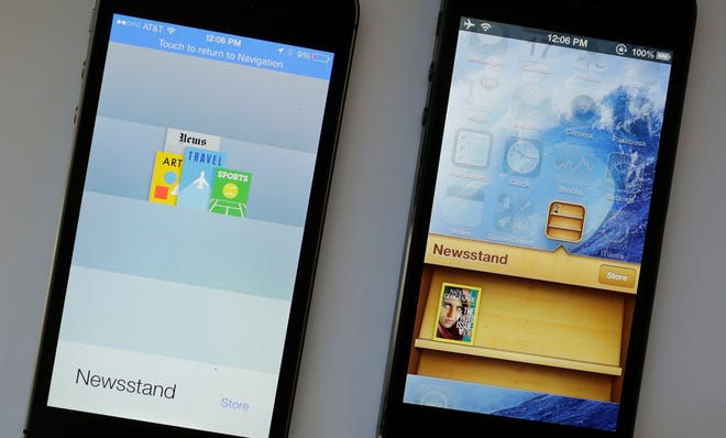 An iPhone with iOS 7 software, left, is displayed next to an iPhone with the older iOS 6 operating system.