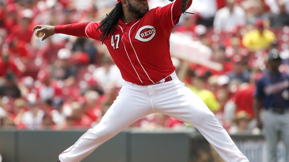 Reds starting pitcher Johnny Cueto delivers against the Twins on July 1.