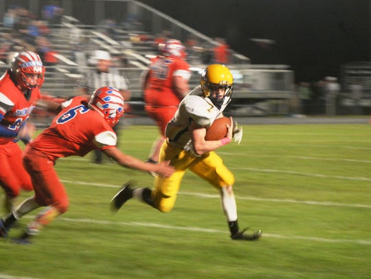 Hagerstown's Owen Golliher runs the ball during a 47-20