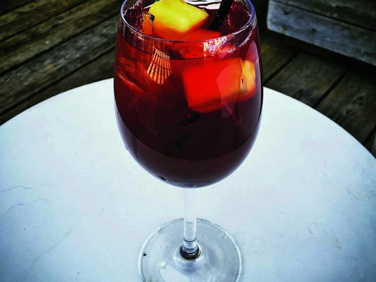 Watermark's red sangria features house-infused pineapple dark rum, red wine, pineapple juice and homemade Grenadine topped with sparkling wine.