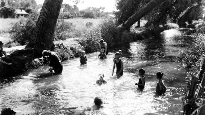 Children swim in a lateral of the Grand Canal. Swimming in the canals was common until the 1960s, when pools become more popular and changes to the infrastructure of the canals made the waterways more treacherous.