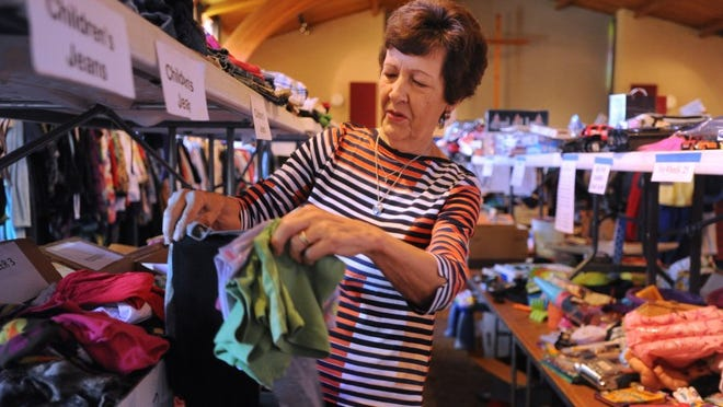 Sally Villers, shown sorting through children's clothing donations for Aldersgate United Methodist Church's annual rummage, came up with the idea of Aldersgate Alive 10 years ago.