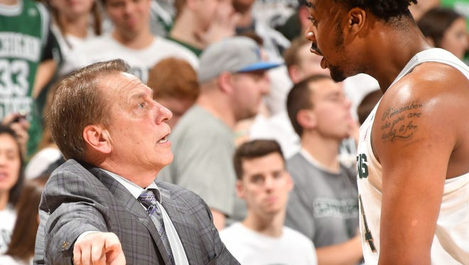 Tom Izzo gets in a heated discussion with Michigan State freshman Nick Ward on the sideline.