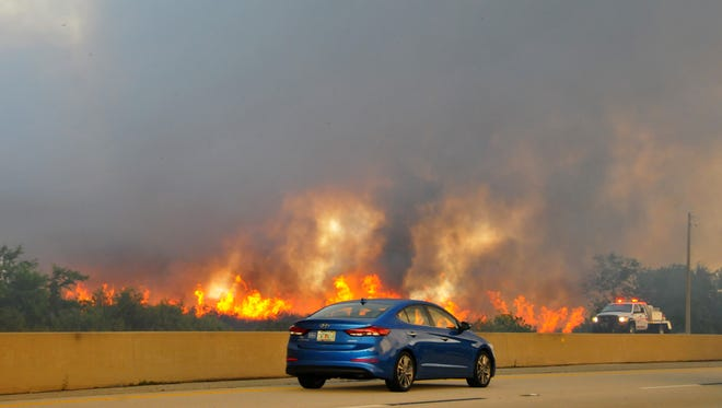 Smoke from the fire had authorities eventually  shut down north and southbound traffic on I-95 between Fiske and 520 Tuesday morning.
