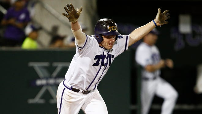 TCU's Boomer White hit the go-ahead RBI single in the 22nd inning against Sam Houston on Saturday night. He's shown here with the game-winner against Siena.