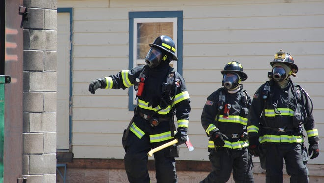 Firefighters take part in a live burn exercise at the PFA Training Facility in west Fort Collins on May 3, 2016.
