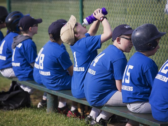 The King Jewelers baseball team lines up on the bench at Wattles Park on Monday.
