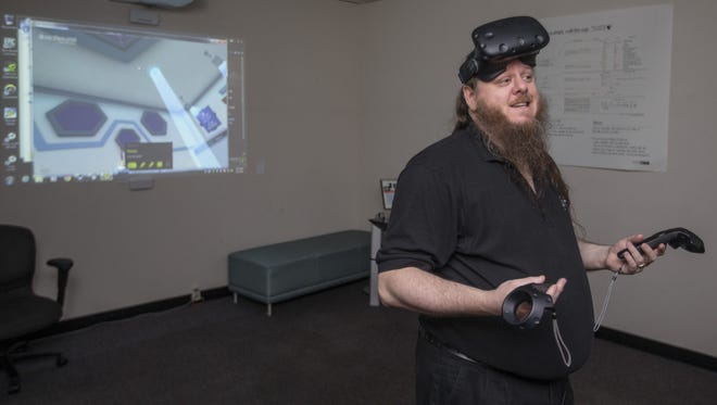 Derric Clark of the University of Advancing Technology in Tempe demonstrates virtual reality technology last year.