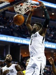 Memphis Grizzlies forward James Ennis III dunks against