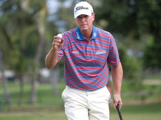 FILE -In this Jan. 15, 2016, file photo, Steve Stricker waves to the gallery on the 12th green during the second round of the Sony Open golf tournament in Honolulu. Stricker is as busy as ever, especially as he gets ready to host the inaugural Champions Tour event in Madison in late June. (AP Photo/Marco Garcia, File)
