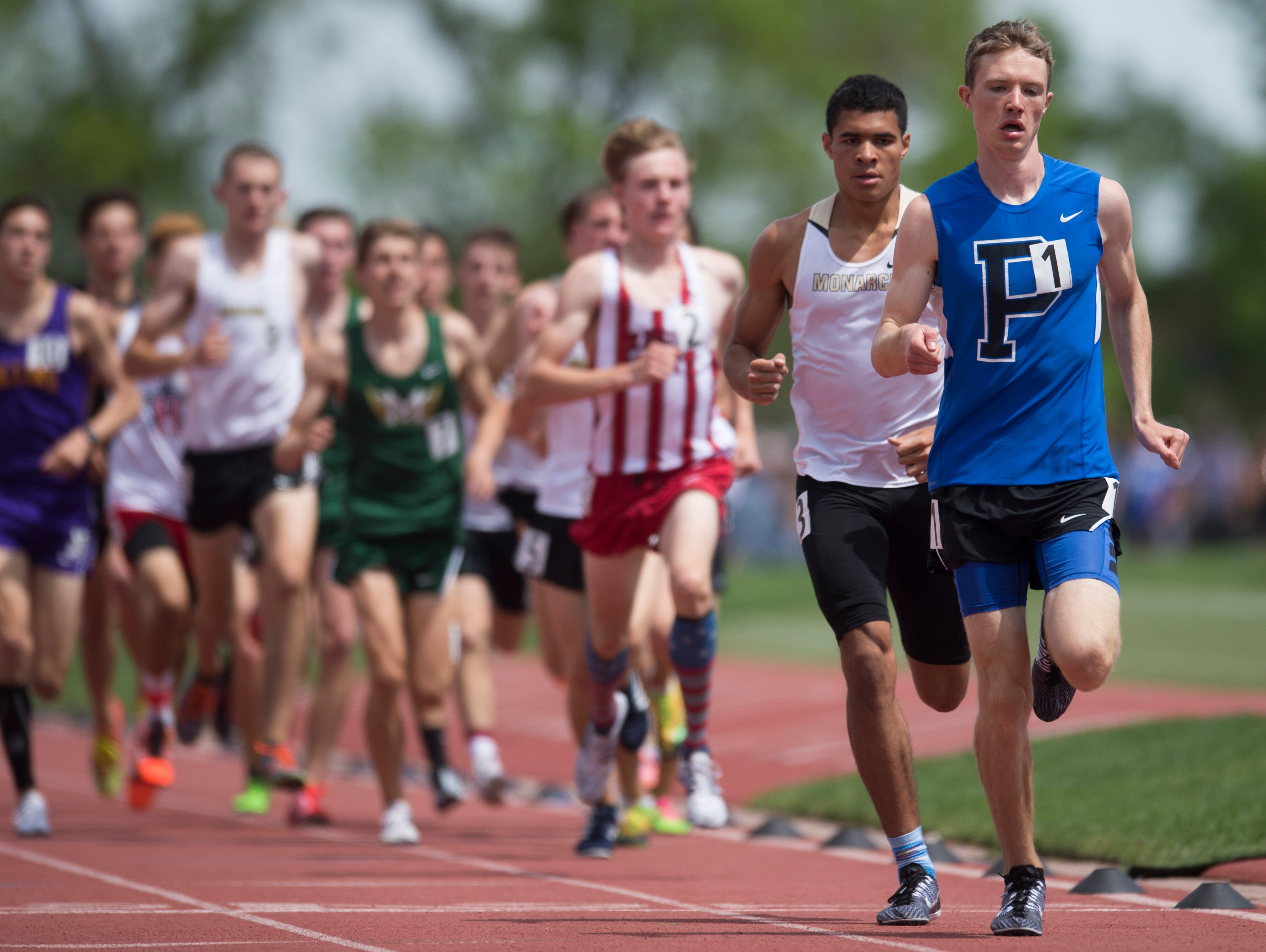Poudre High School's Henry Raymond sets the pace in the boys Class 5A 1,600 meters Saturday while claiming his third state title in as many days at the Colorado state track and field championships at Jeffco Stadium in Lakewood.