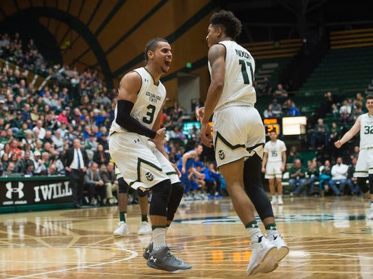 CSU basketball player Gian Clavell, left, celebrates with teammate Prentiss Nixon after Nixon dunked the ball for a basket during the Rams' 85-58 win over Air Force last Saturday at Moby Arena.
