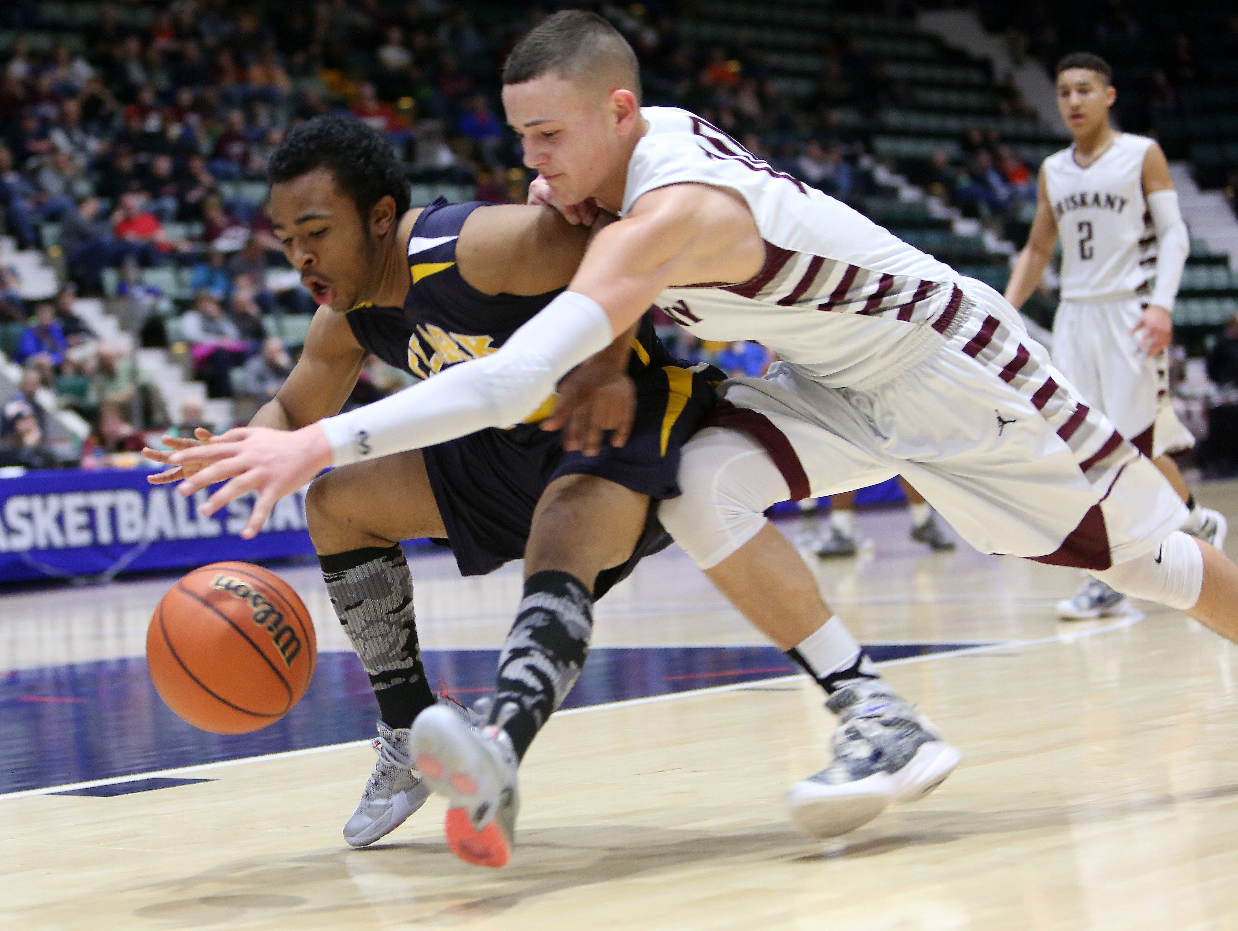 From left, Clark Academy's Brice Banks (10) and Oriskany's Kyle Liddy (10) battle for a loose ball during the boys Class D semifinal at the Glens Falls Civic Center March 11, 2016. Oriskany won the game 59-40.