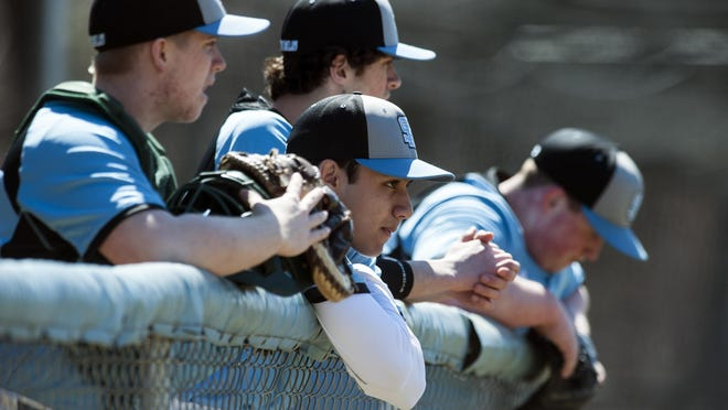 The South Burlington bench watches the game during the boys high school baseball game between the Mount Mansfield Cougars and the South Burlington Rebels at South Burlington High School on Saturday April 16, 2016 in South Burlington, VT.