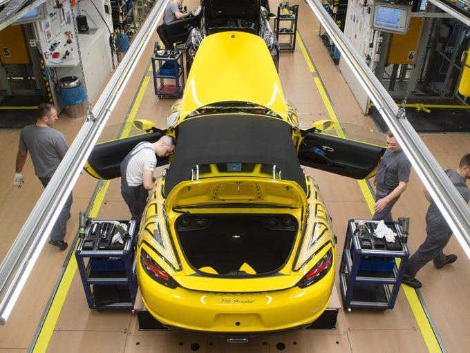 Employees assemble a Porsche Boxster  Feb. 24, 2017.
