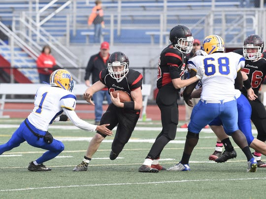 Cardinals quarterback Collen Hills takes off against Oneonta in Section 4 title game.