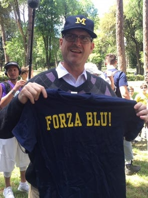 "Michigan football coach Jim Harbaugh shows his ""Forza"