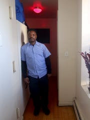 Terry Johnson of Mount Vernon in his one-bedroom apartment.