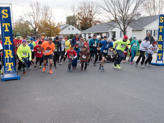 Runners start at the Feeding Frenzy 5K to benefit the Caring Cupboard of Palmyra. This year's event is held Saturday, Oct. 20.