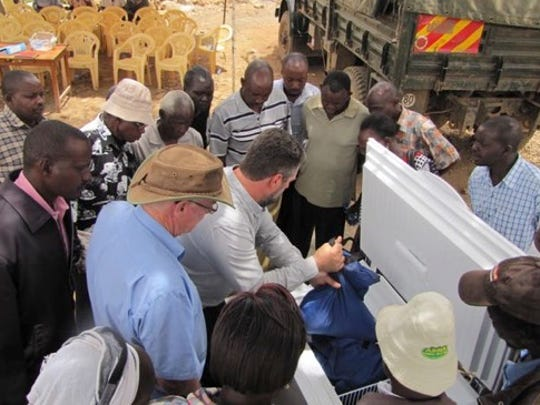 Brian Jensen, SunDanzer program manager, in March showed dairy farmers in Kenya how to store milk in a special  refrigerator made by the company.
