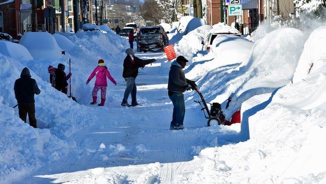 Snow shovelers and snowblowers are digging out along Washington Street, Chambersburg Sunday, Jan. 24, 2016.