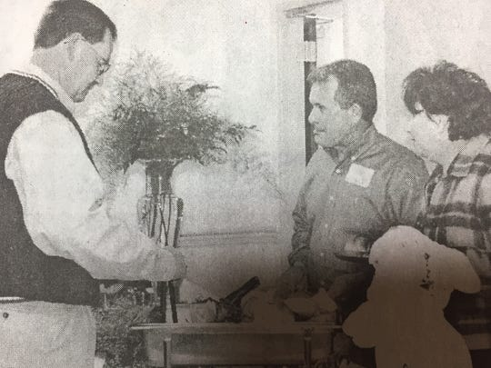 From the left, Joe Wells, Joe Woodring and Patty Wells enjoyed the buffet at the Integra Bank meeting held in March 2002.
