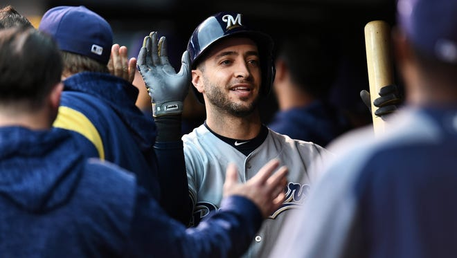 Ryan Braun is greeted after his sacrifice fly.
