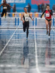 Purdue's Symone Black races to the finish ahead of Wisconsin's Brenna Detra, right, while winning the women's 400-meter hurdles at the Drake Relays Friday in Des Moines, Iowa.