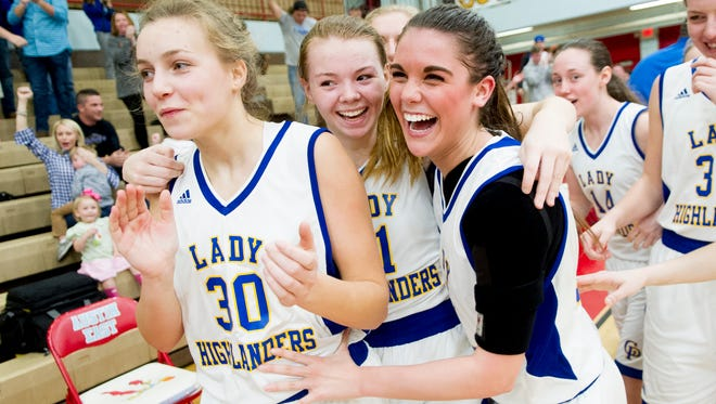 Gatlinburg's Ivy Jones, left, Sophie Henry, center, and Kennedy Smith celebrate after defeating Fulton on Wednesday during the Region 2-AA finals Wednesday at Austin-East High School in Knoxville, Tennessee on Wednesday, March 1, 2017.