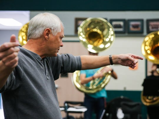 Jim Bode instructs the marching band Wednesday, Oct.