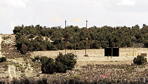 Burn-off from flaring is pictured June 13, 2014, near Lybrook, New Mexico. North Dakota officials are concerned about the increased use of this practice at the Fort Berthold Indian Reservation.