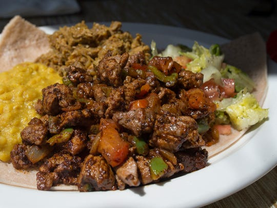 Lamb tibs and lamb alicha is served with yellow split peas at Nyala Ethiopian Cuisine at 2900 Harvard St. in Fort Collins.
