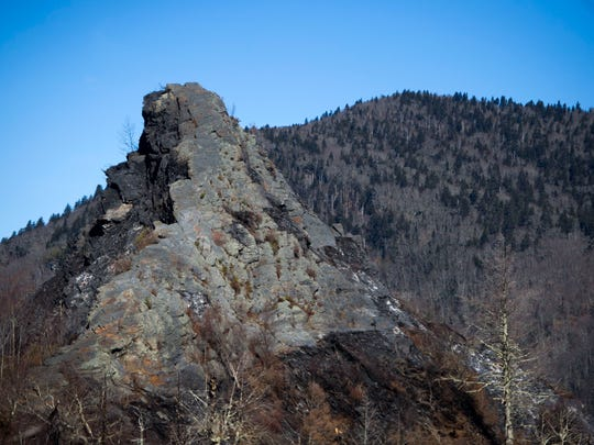Severe burn damage is visible on a rock face at the summit of Chimney Tops trail Thursday, Feb. 16, 2017. The trail is closed to the public due to November's wildfire damage and will remain closed through 2017.
