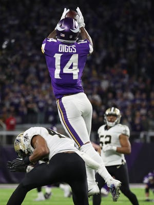 Minnesota Vikings wide receiver Stefon Diggs (14) catches the game-winning touchdown pass against New Orleans Saints free safety Marcus Williams (43) during the fourth quarter in the NFC Divisional Playoff football game at U.S. Bank Stadium.