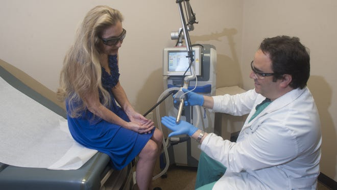 Dr. Eric B. Grossman, an obstetrician/gynecologist,  talks with Joan McHugh-Fithian of Medford about a minimally invasive treatment called MonaLisa Touch, a laser procedure to help women suffering from the effects of menopause.