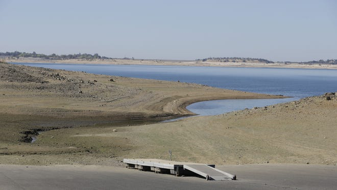 A dock sits high and dry at the end of a boat ramp yards away from the edge of Folsom Lake near Folsom, Calif., on Monday, Oct. 6, 2014.